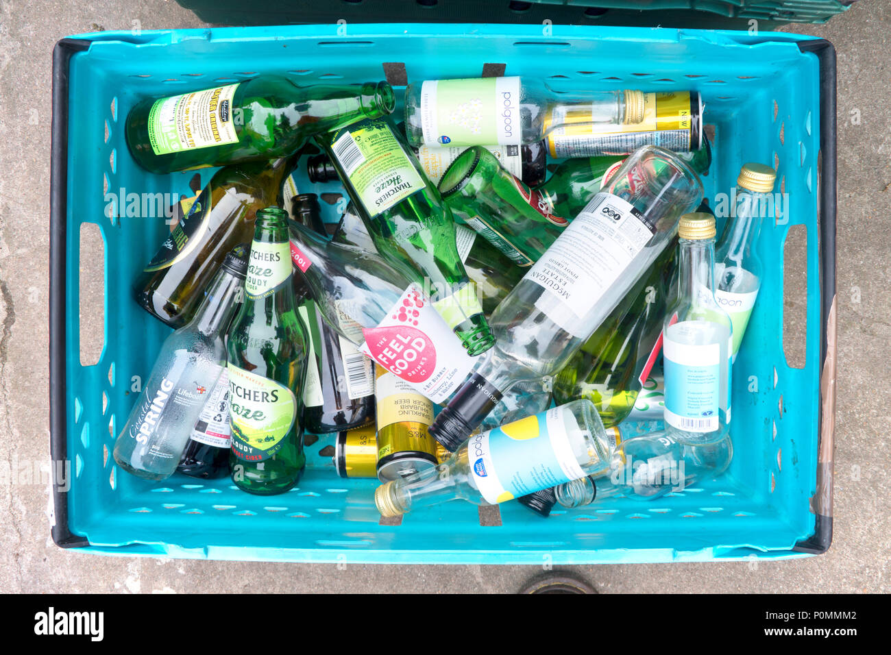Overhead view of a basket of bottles waiting to be recycled - John Gollop - Stock Image