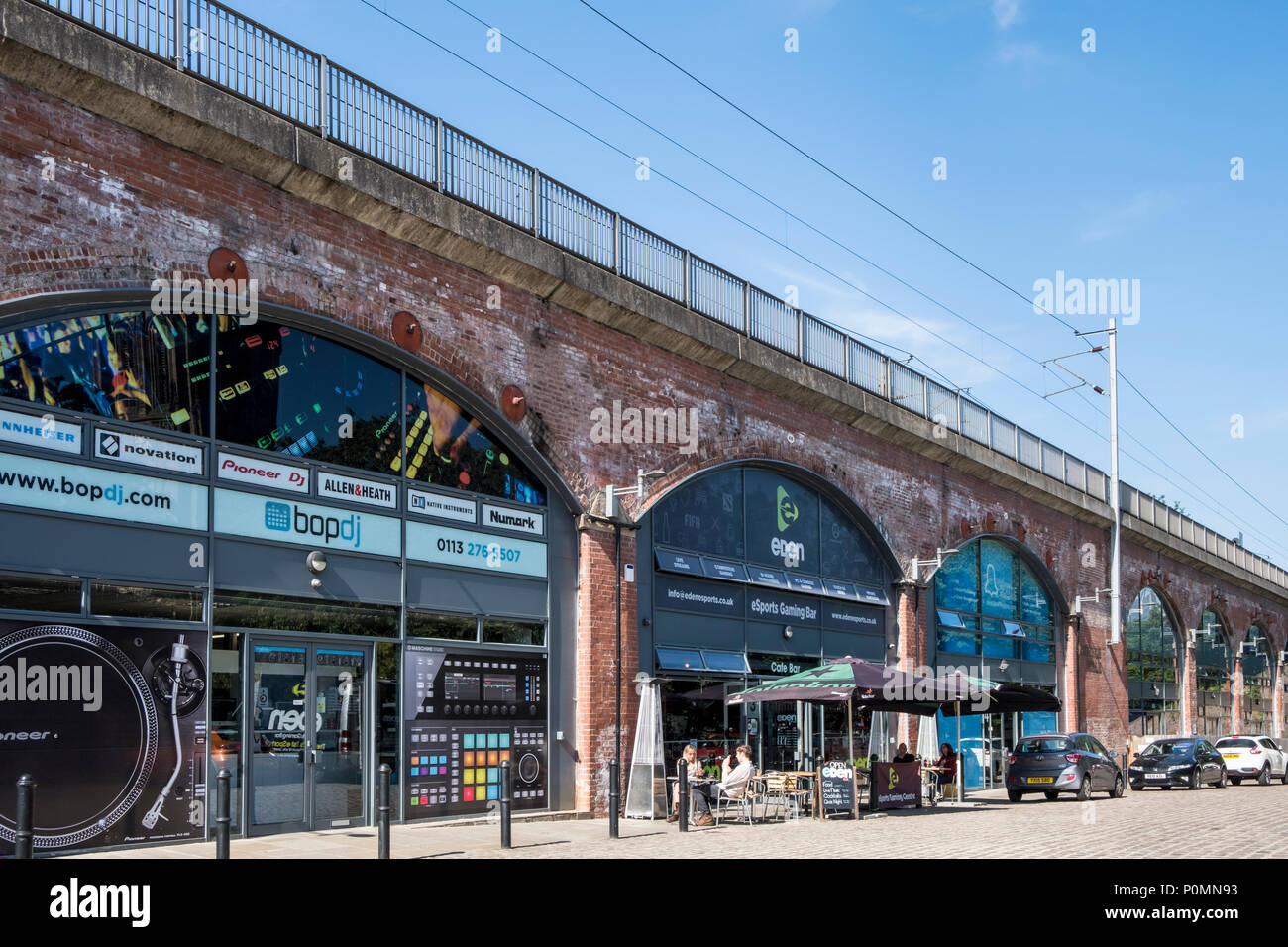Railway arch businesses, Leeds, West Yorkshire, England, UK - Stock Image