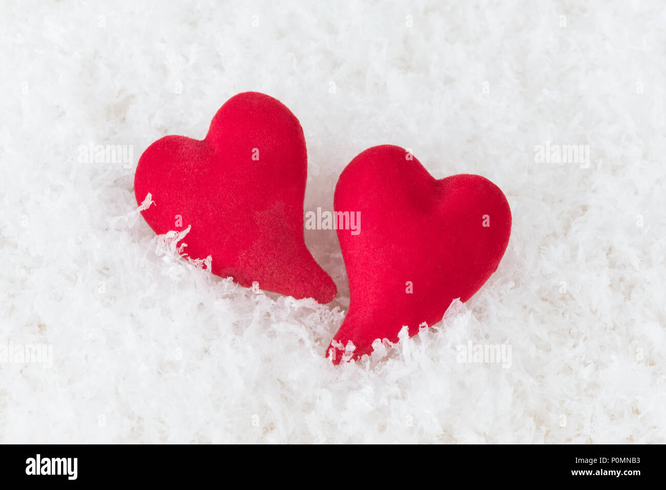 Two Red Hearts Lie On White Puffy Cold Snow Metaphor Of Love
