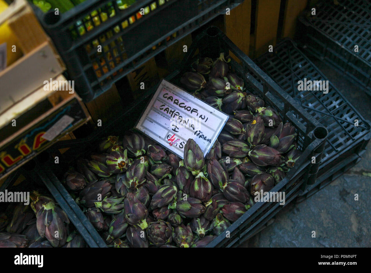 Fiesole artichokes for sale in a Sorrento market, which are a special baby artichoke variety with a rich purple colour - Stock Image