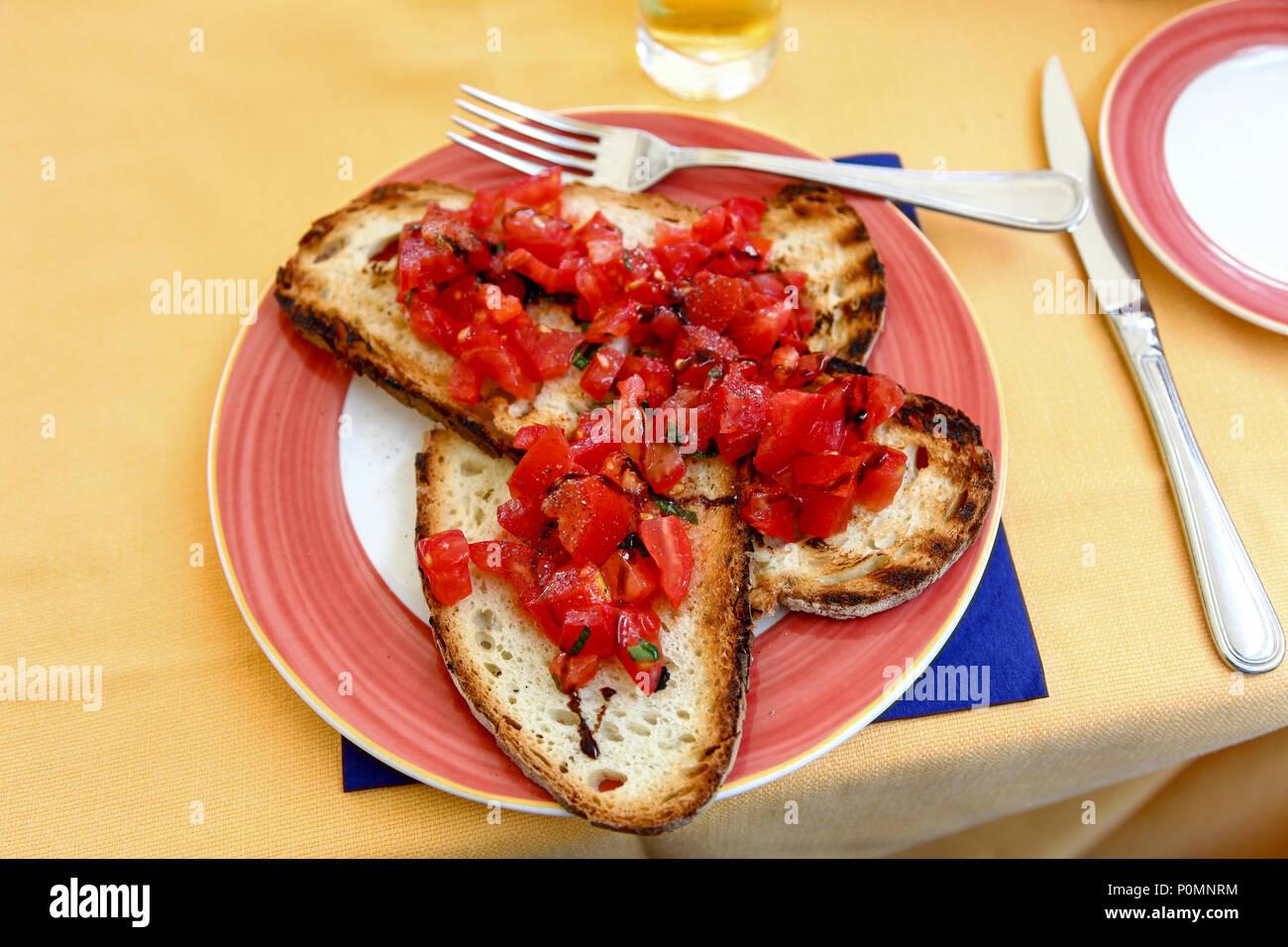 Tomato Bruschetta on a café table in Sorrento, Italy - Stock Image