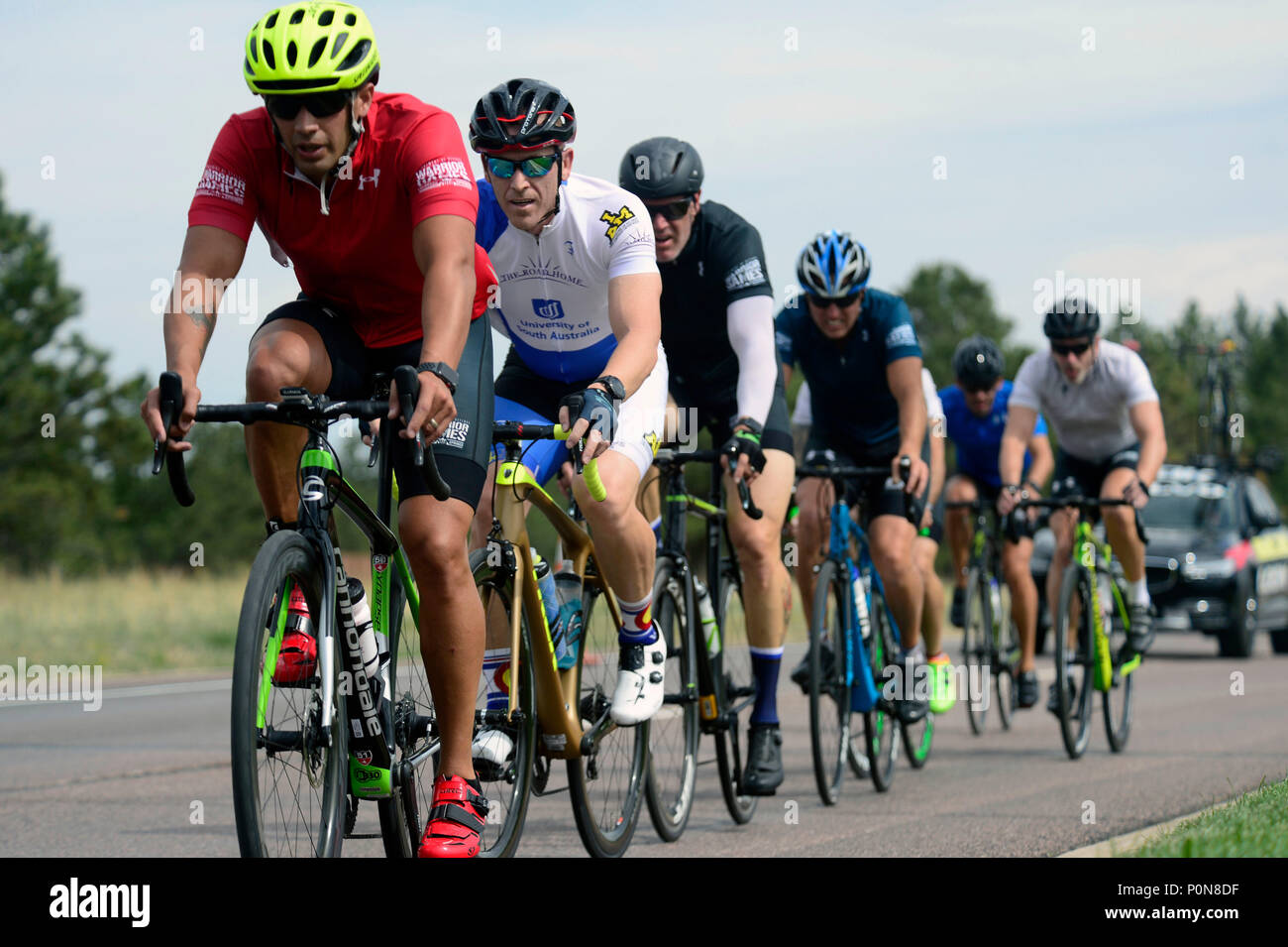 A peloton in the cycling distance race during the 2018 Warrior Games held at the Air Force Academy in Colorado Springs June 6, 2018. Created in 2010, the DoD Warrior Games introduce wounded, ill and injured service members and veterans to Paralympic-style sports. Warrior Games showcases the resilient spirit of today's wounded, ill or injured service members from all branches of the military. These athletes have overcome significant physical and behavioral injuries and prove that life can continue after becoming wounded, ill or injured.  (Photo by Michael Bottoms, USSOCOM Office of Communicatio Stock Photo