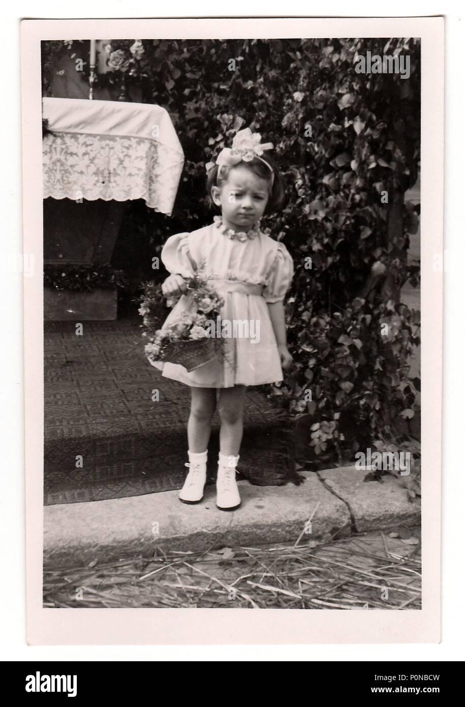 HODONIN, THE CZECHOSLOVAK REPUBLIC, CIRCA 1943:  Vintage photo shows a small girl during religious (catholic) celebration, circa 1943. - Stock Image