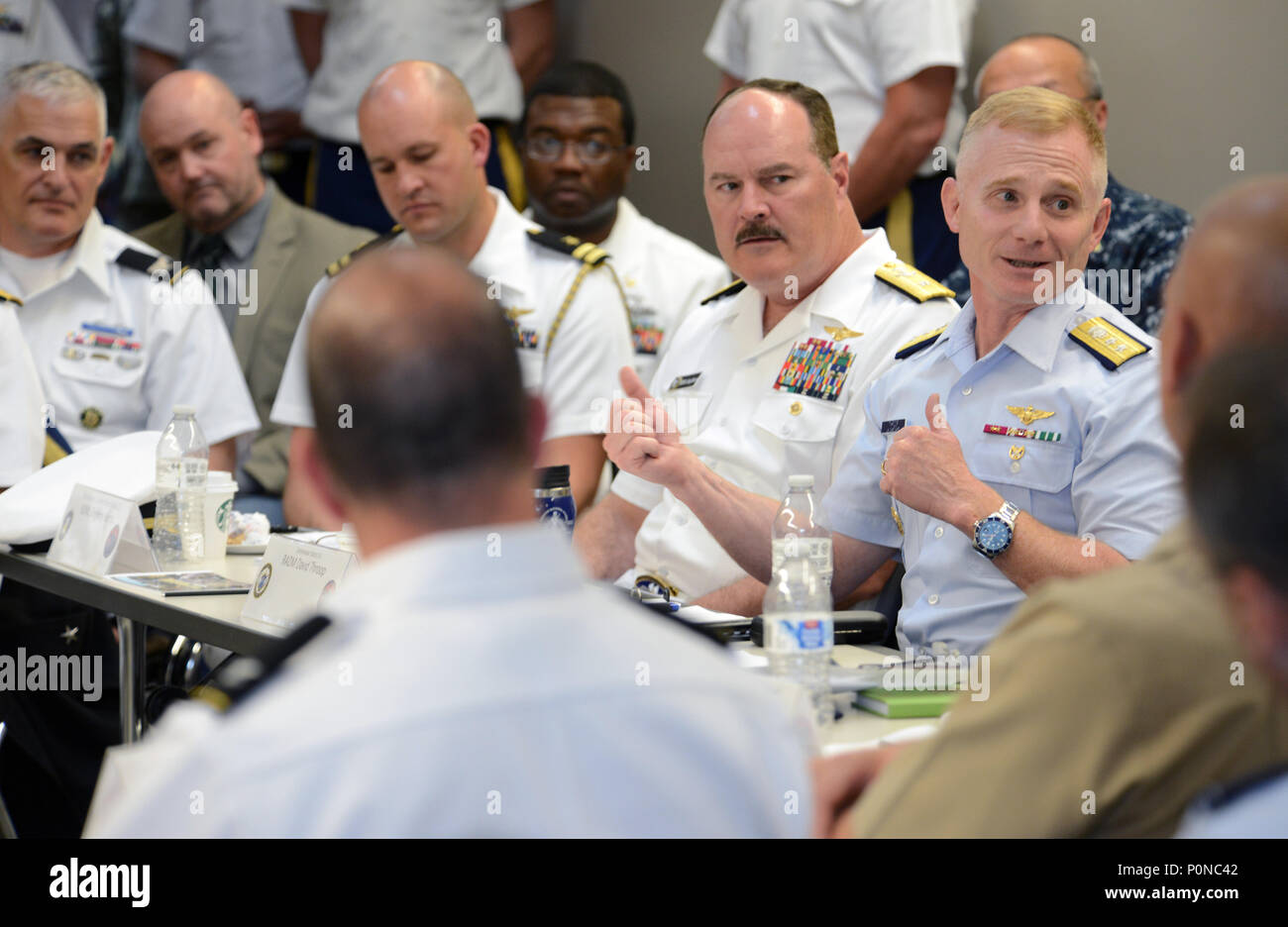 U.S. Coast Guard Rear Admiral David G. Throop (right), 13th Coast Guard District commander, offers final comments and remarks during the Portland Rose Festival Defense Support of Civil Authorities (DSCA) seminar held at Camp Withycombe, in Clackamas, Oregon, June 7, 2018. The one-day event brought together senior leadership from the Oregon and Washington National Guard, U.S. Navy, Coast Guard, and other civil emergency managers as they review the Cascadia Subduction Zone Planning. (National Guard photo by John Hughel, Oregon Military Department Public Affairs) - Stock Image