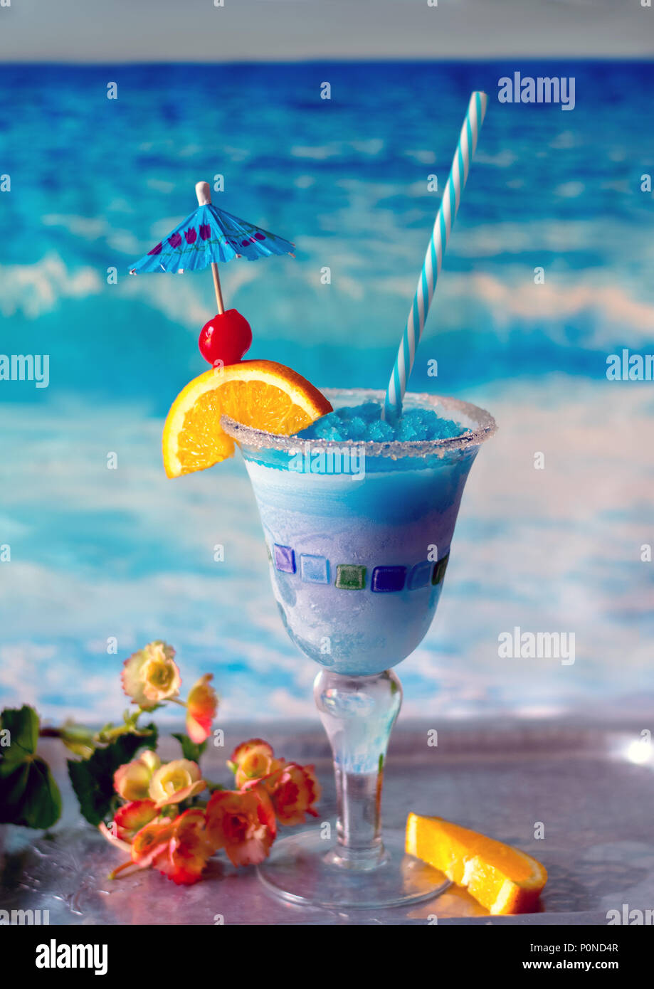 delicious frozen drink called a blue whale, with ice, lemonade, citrus vodka and curacao blue - Stock Image