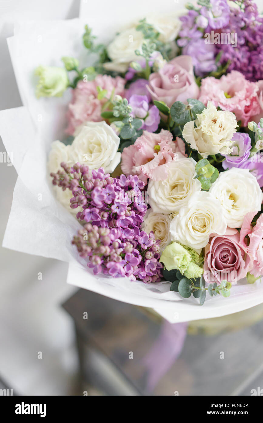 Floristry concept bouquet of beautiful flowers on gray table bouquet of beautiful flowers on gray table spring colors the work of the florist at a flower shop izmirmasajfo
