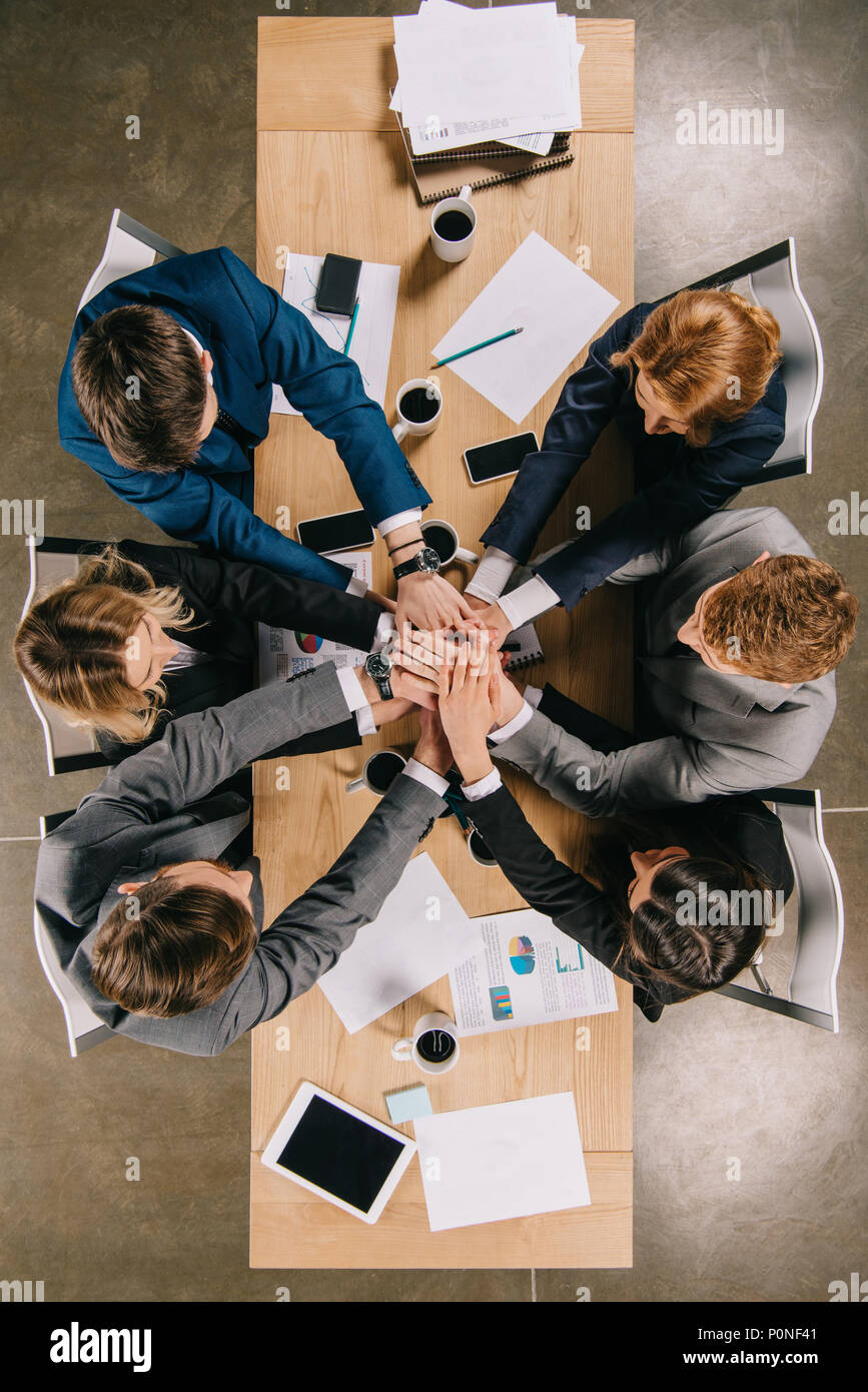 overhead view of business partners at table in office, businesspeople teamwork collaboration relation concept - Stock Image
