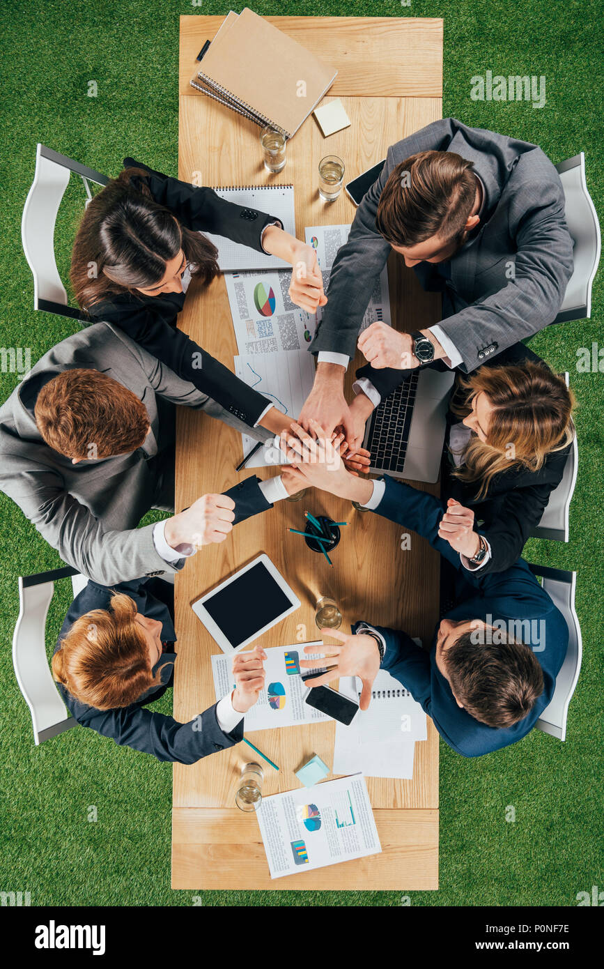 Top view of business partners at table in office, businesspeople teamwork collaboration relation concept - Stock Image