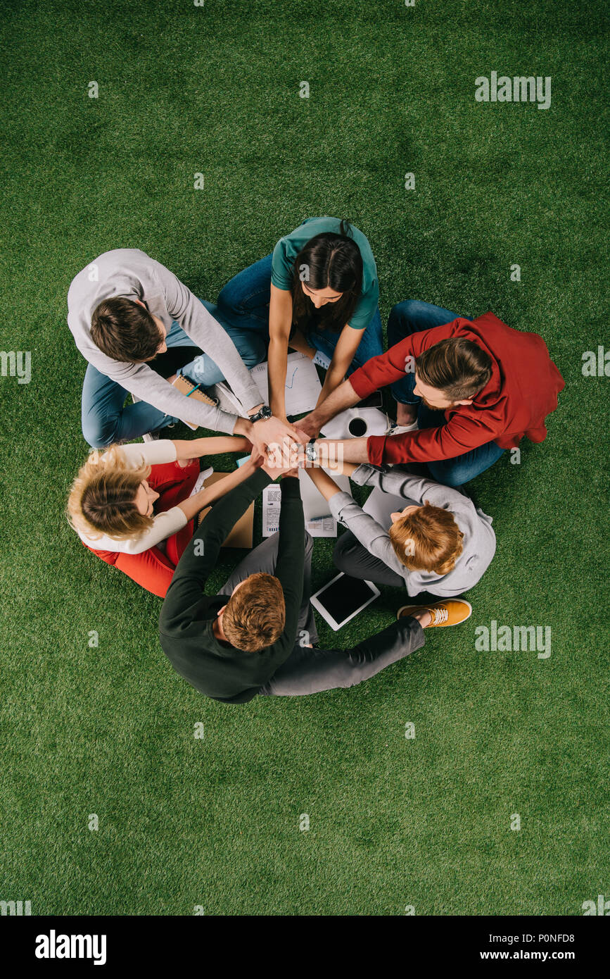 Top view of business partners on grass, businesspeople teamwork collaboration relation concept - Stock Image