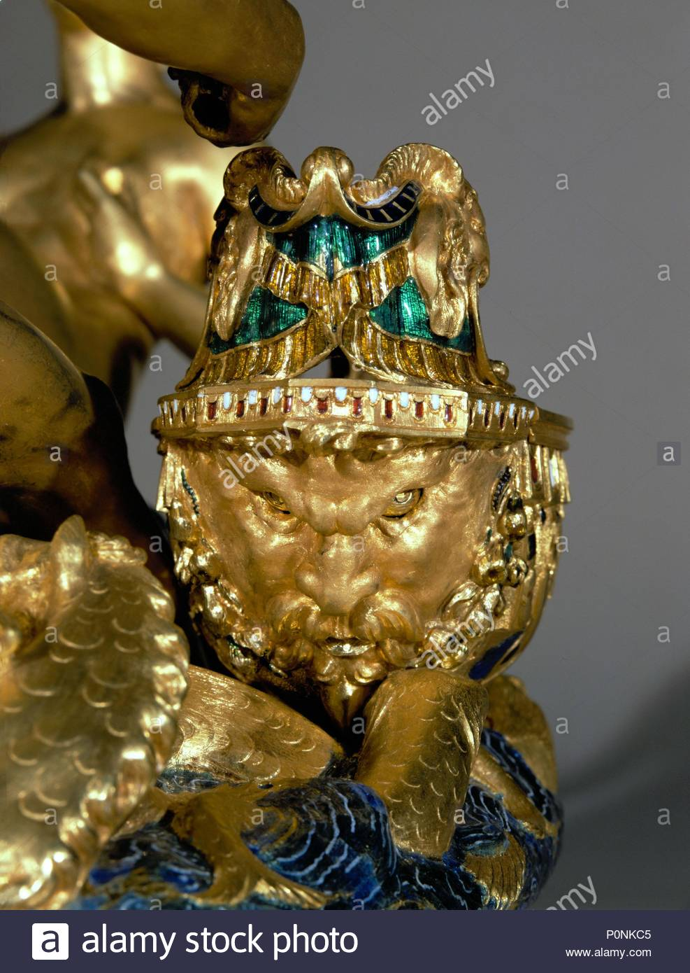 Ship stern in form of grim face. Detail of the saliera (saltcellar) Neptune (sea) and Tellus (earth). Gold, niello work, and ebony base (1540-1543) Height 26 cm Inv. 881. Author: Benvenuto Cellini (1500-1571). Location: Kunsthistorisches Museum, Kunstkammer, Vienna, Austria. - Stock Image