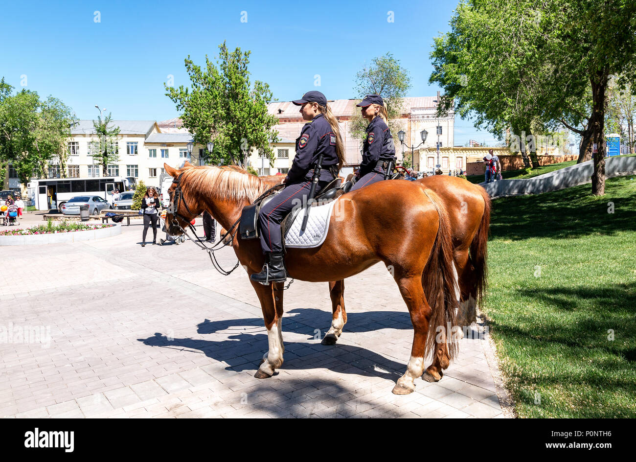 Samara, Russia - May 27, 2018: Female mounted police on horse back at the city street - Stock Image