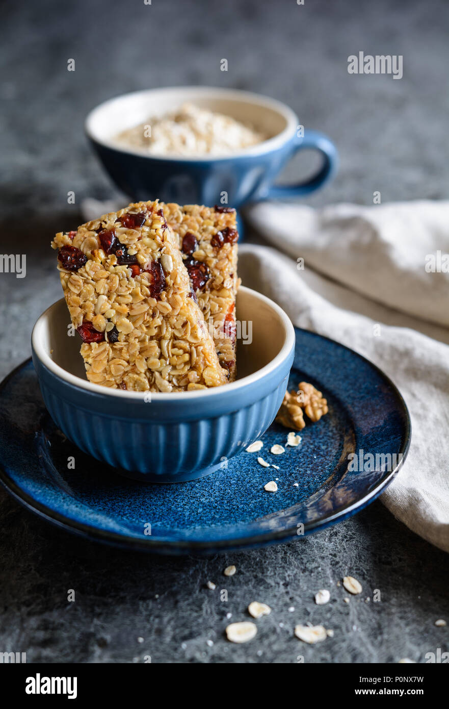 Healthy granola bars with cranberries, walnuts, sunflower seeds and raisins - Stock Image