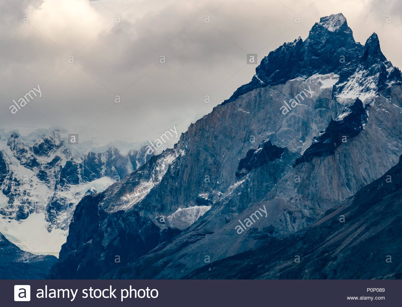 Granite intrusion with hornblende rock, Paine Horns mountain peaks of Torres del Paine National Park, Patagonia, Chile, South America - Stock Image
