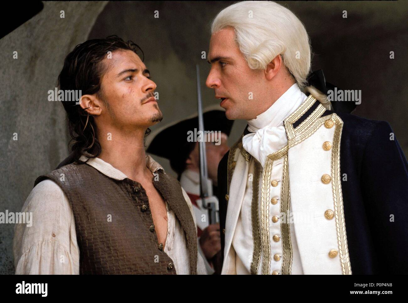 Original Film Title: PIRATES OF THE CARIBBEAN: THE CURSE OF THE BLACK PEARL.  English Title: PIRATES OF THE CARIBBEAN: THE CURSE OF THE BLACK PEARL.  Film Director: GORE VERBINSKI.  Year: 2003.  Stars: JACK DAVENPORT; ORLANDO BLOOM. Credit: TOUCHSTONE PICTURES / Album - Stock Image