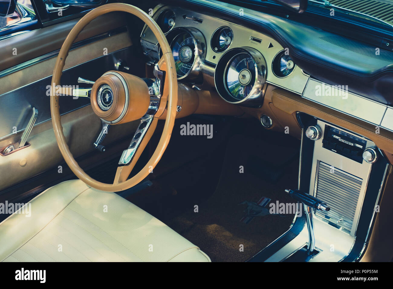 Berlin germany june 09 2018 steering wheel dashboard and interior of ford mustang vintage car cockpit at oldtimer event for vintage cars and