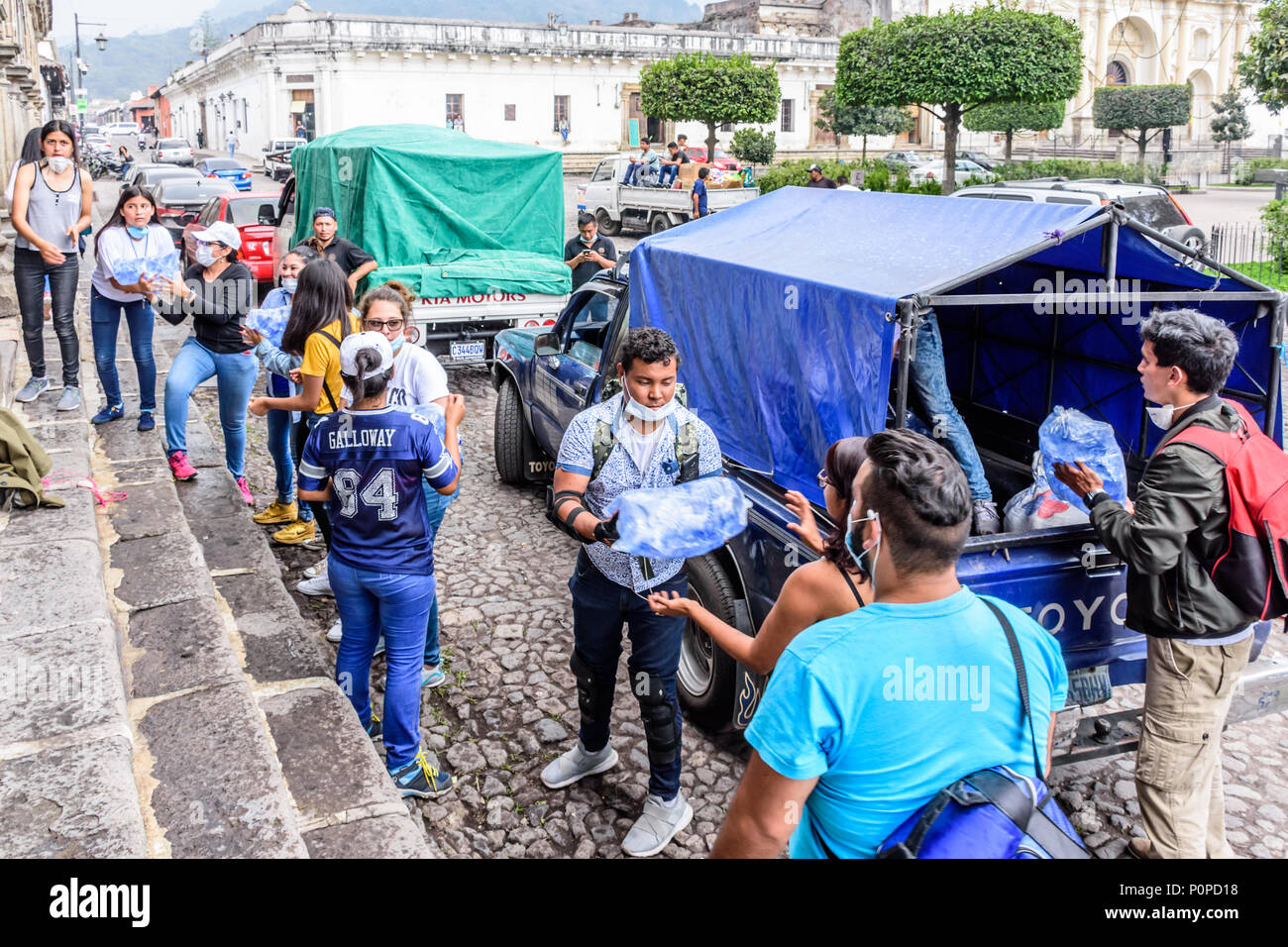 Antigua,, Guatemala -  June 5, 2018:  Volunteers load aid supplies to take to area affected by eruption of Fuego volcano on June 3 - Stock Image
