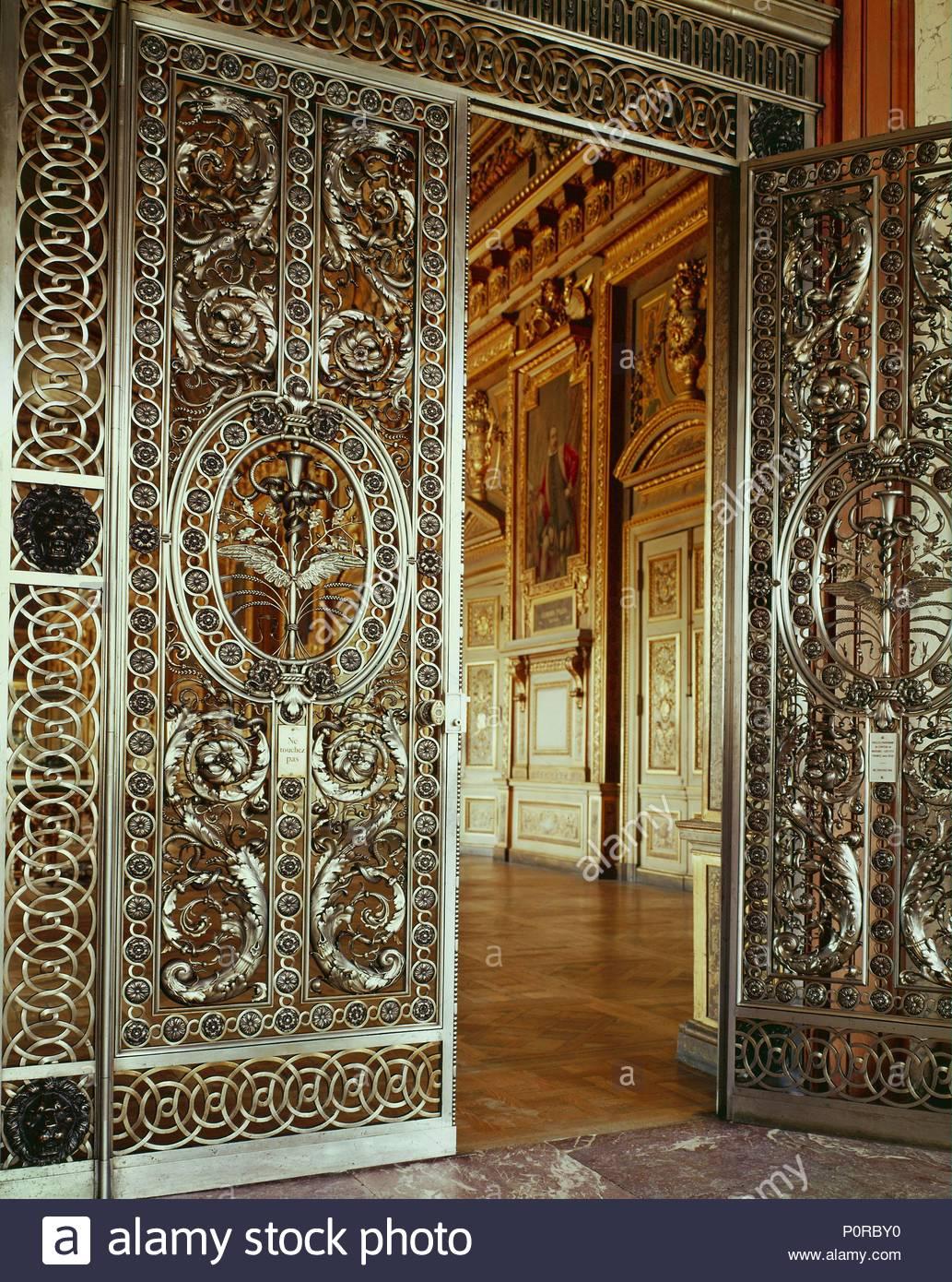 Doors of the Galerie d'Apollon, 1650-wrought iron and silver. From the Chateau de Maisons. Location: Louvre, Dpt. des Objets d'Art, Paris, France. - Stock Image
