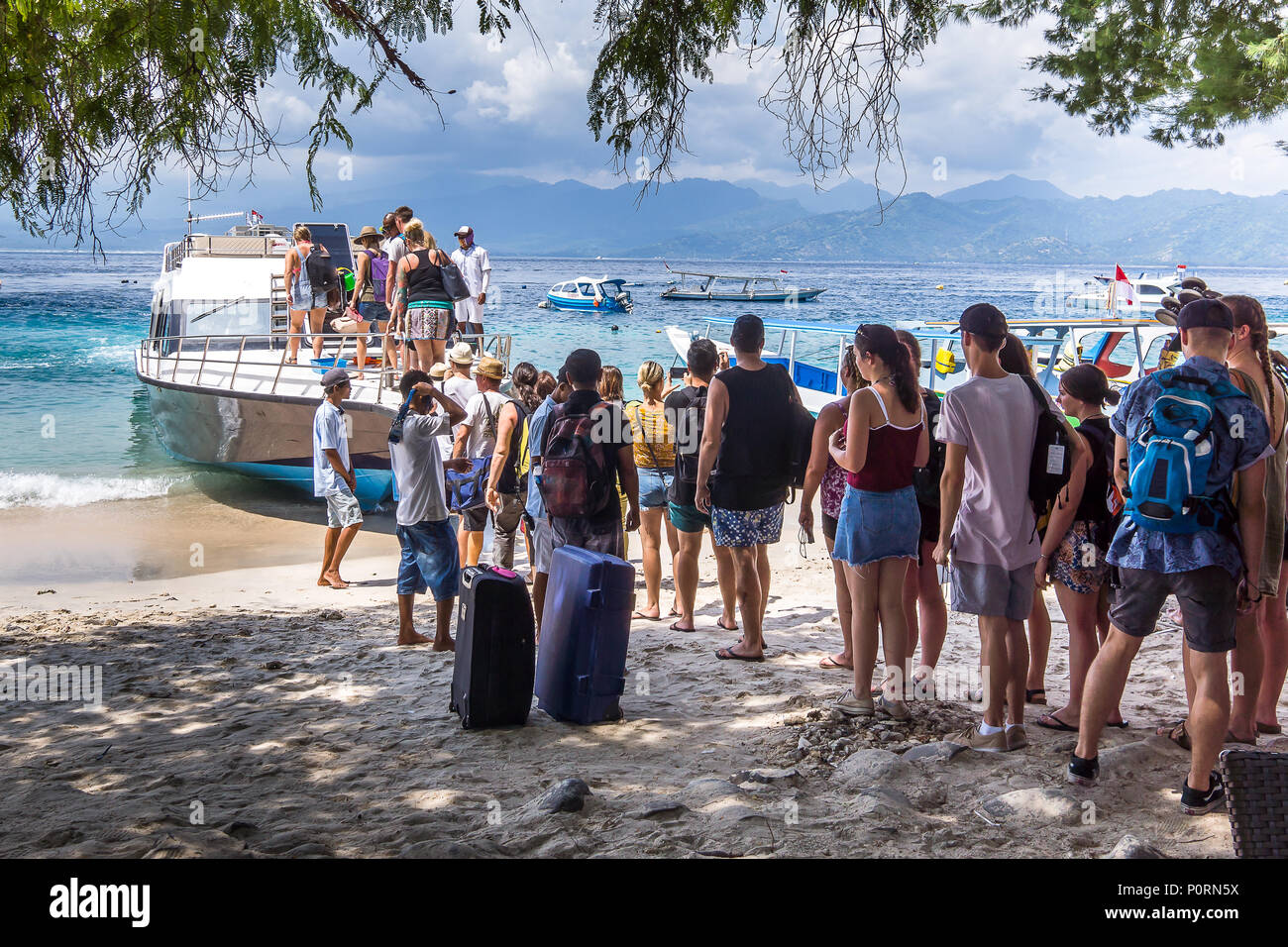 Ferry from Gili Trawangan and Lombok to Bali, tourists standing in line and embark the ferry, Gili Trawngan, Indonesia - Stock Image