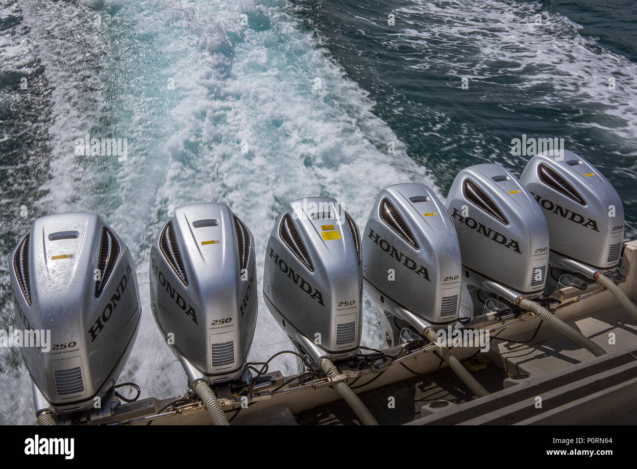 Speedboat from Lombok to Bali, six outboard motors driving the boat on the foaming sea, Bali, Indonesia, April 26, 2018 - Stock Image