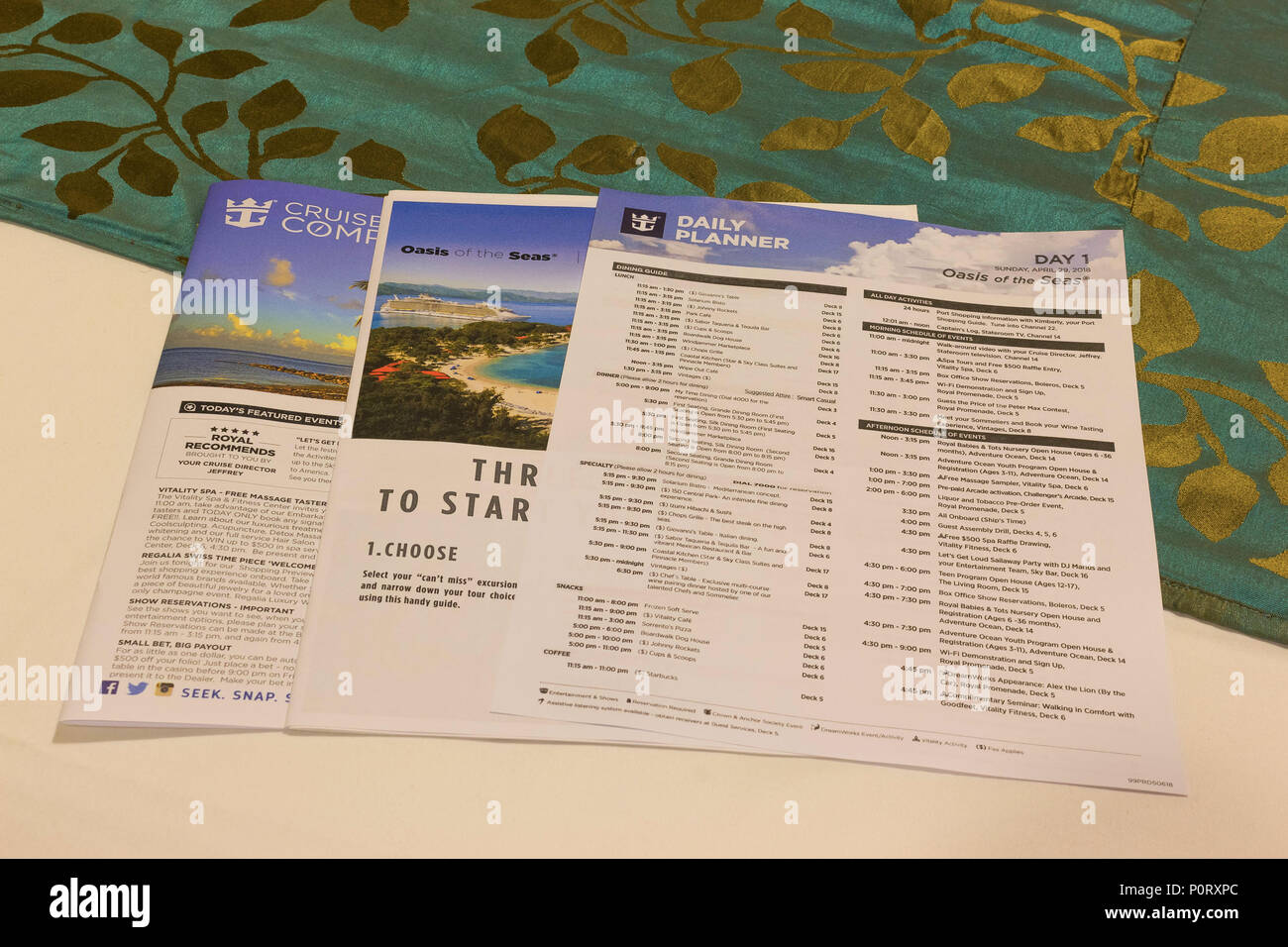 Cape Canaveral, USA - APRIL 29, 2018: The Daily Planner and Cruise Compass newspapers at cruise ship Oasis of the Seas - Stock Image