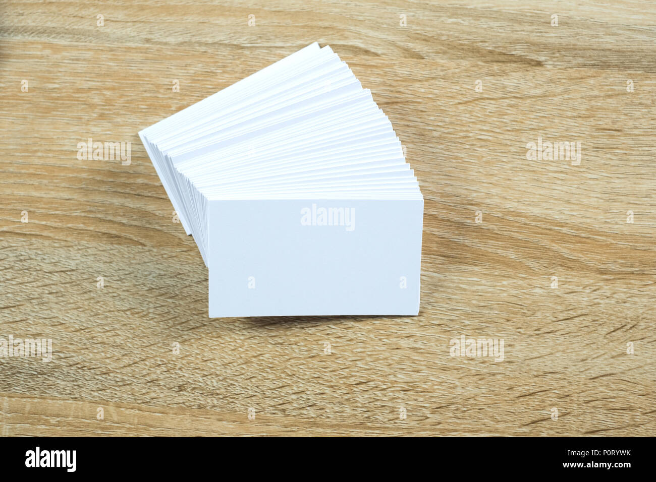 Blank business cards on wooden working table with copy space for add blank business cards on wooden working table with copy space for add text id and logo business company concept idea colourmoves