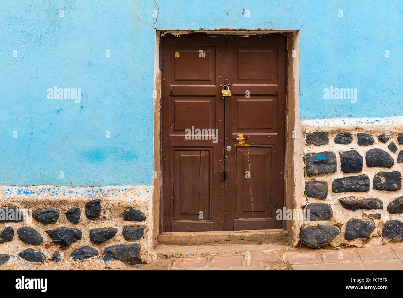 Colourful facade with wooden door in the city center of Potosi (Unesco World Heritage Site), famous for its colonial architecture, Bolivia. Stock Photo