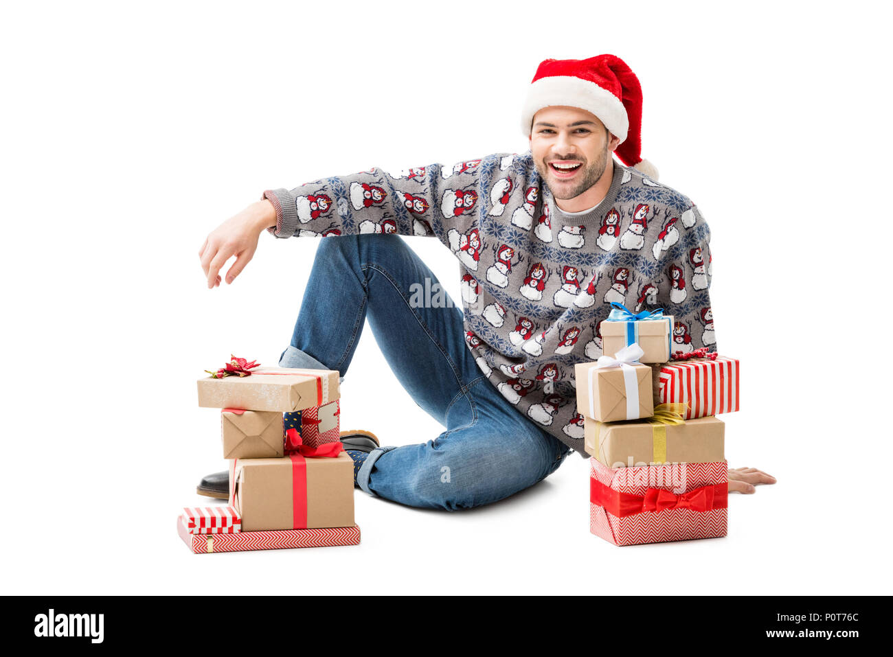 young man sitting on floor with stacks of christmas gifts isolated on white  sc 1 st  Alamy & young man sitting on floor with stacks of christmas gifts isolated ...