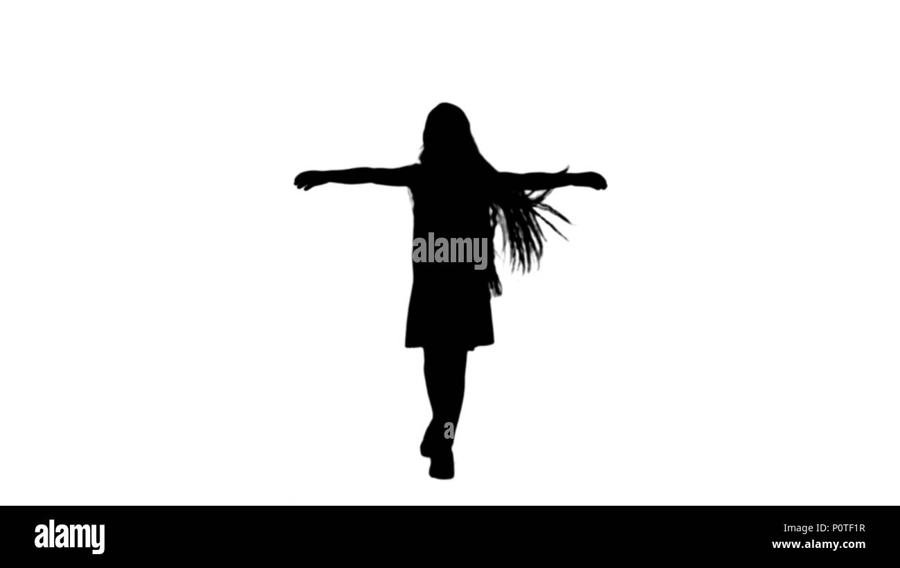 Silhouette Dancing little blond girl singing track matte Stock Photo