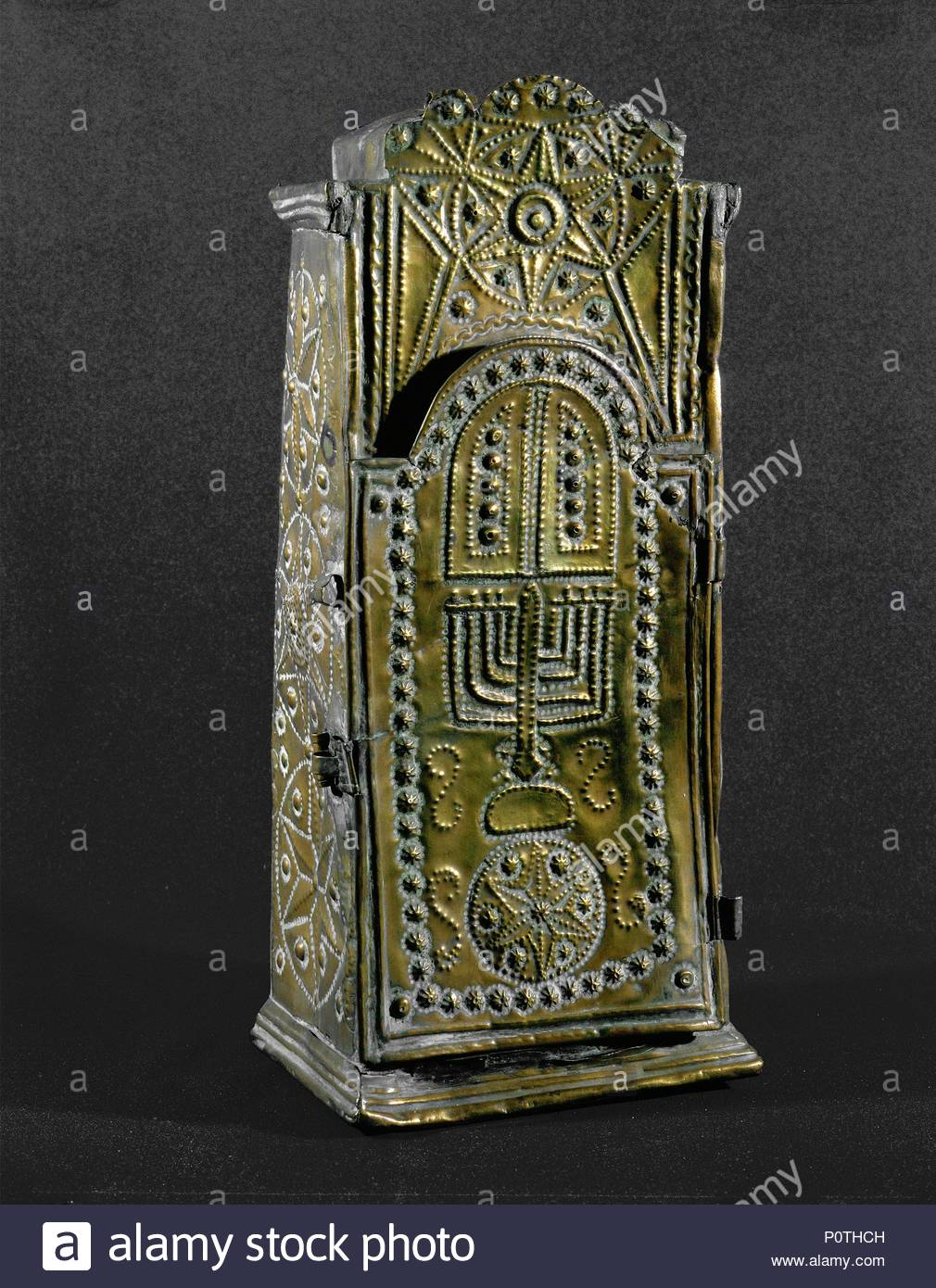 Miniature Ark, or Torah shrine. A menorah and the tablets with the ten commandments appear on the doors. From Russia. Punchwork on sheet brass, 41 x 18 x 14 cm. Location: Israel Museum, Jerusalem, Israel. - Stock Image