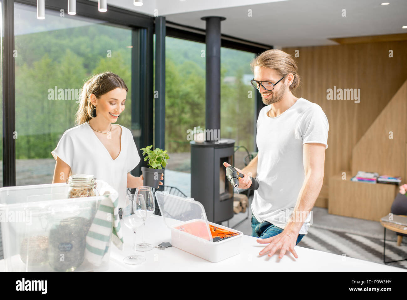 Couple making order in their new modern house - Stock Image