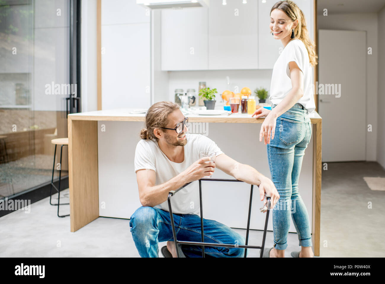 Couple doing house chores at the modern apartment - Stock Image