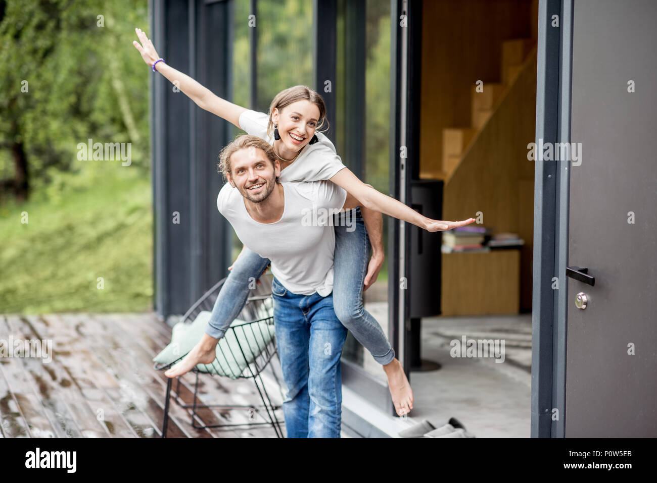 Happy couple on the house terrace - Stock Image
