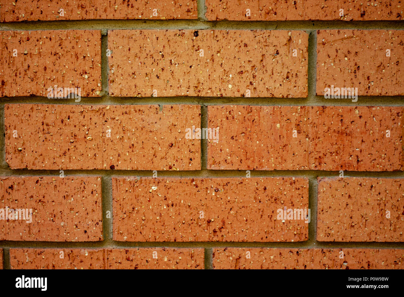 Red orange brick wall with texture - Stock Image