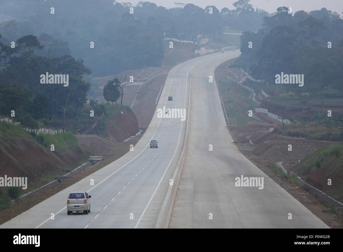 Bogor, Indonesia  09th June, 2018  Vehicles cross Bocimi in