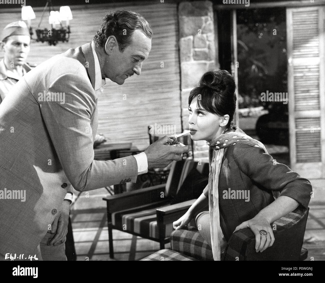Original Film Title: GUNS OF DARKNESS.  English Title: GUNS OF DARKNESS.  Film Director: ANTHONY ASQUITH.  Year: 1962.  Stars: DAVID NIVEN; LESLIE CARON. Credit: WARNER BROTHERS / Album Stock Photo