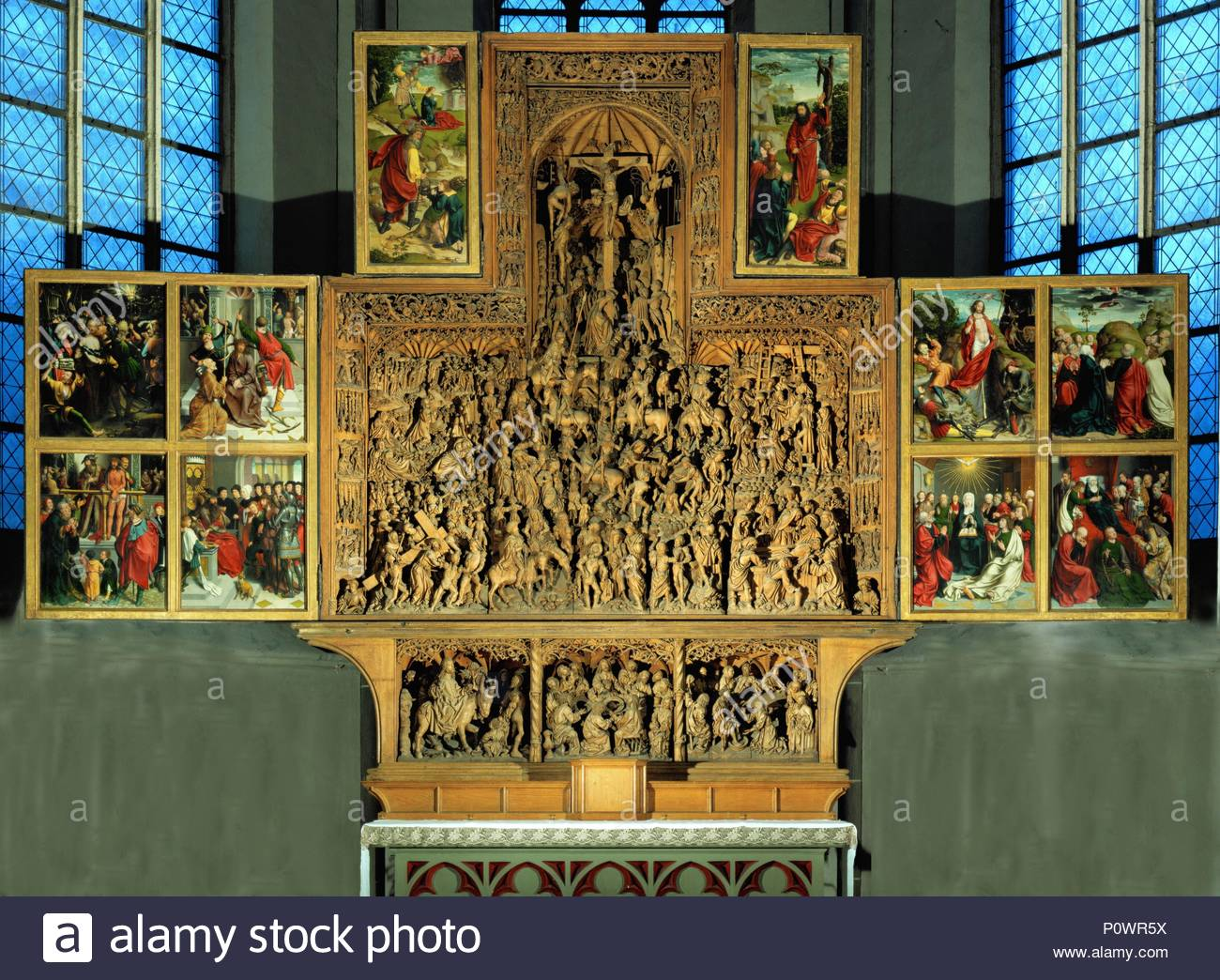 Main altar, woodcarving by Arndt van Zwolle and Ludwig Juppe, 1492; paintings by Jan Joest. Center: Passion. Predella: entry into Jerusalem, Last Supper, carrying the cross. Wings: passion, Pilate hand-washing; Resurrection, Ascension, Whitsun, St. Mary's death. Author: ZWOLLE, ARNDT VAN. Location: Saint Nicolai Church, Kalkar, Germany. - Stock Image