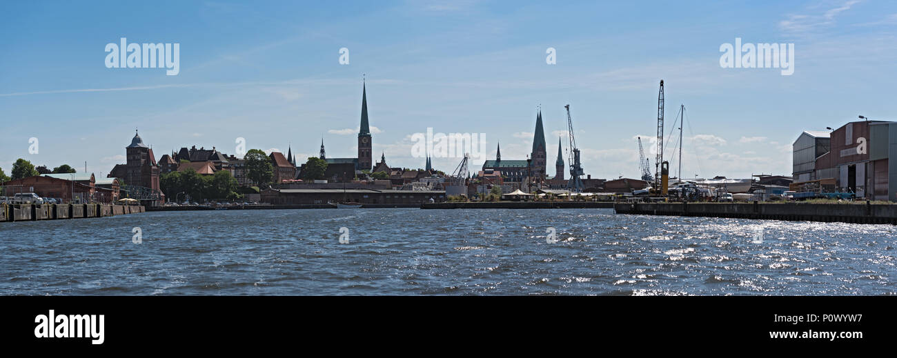 Panorama image of Hanseatic city of Luebeck with trave river, Luebeck, Germany - Stock Image