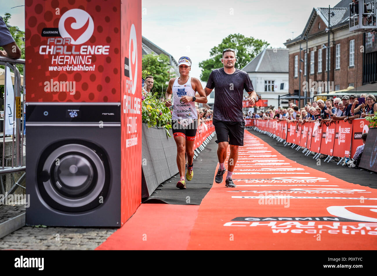 Herning, Denmark, 9th June 2018 UK Sport: Camilla Pedersen is escorted from the course during the middle distance triathlon in Herning  Credit Northern Sport/Alamy Live News Stock Photo
