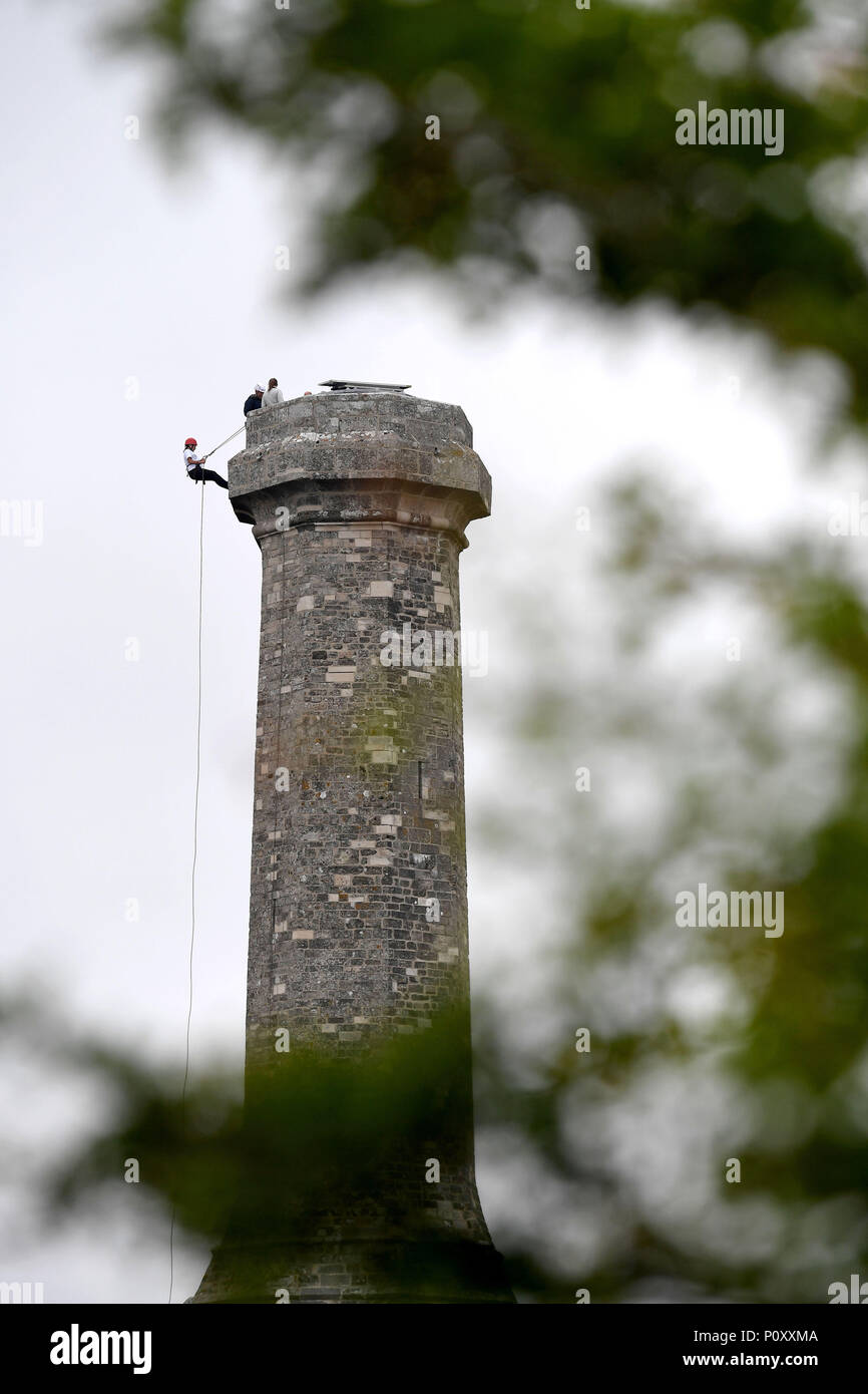 Charity Abseil for The Royal British Legion, abseilers decend down the 72ft Hardy's Monument, Hardy Monument, Dorset, UK - Stock Image