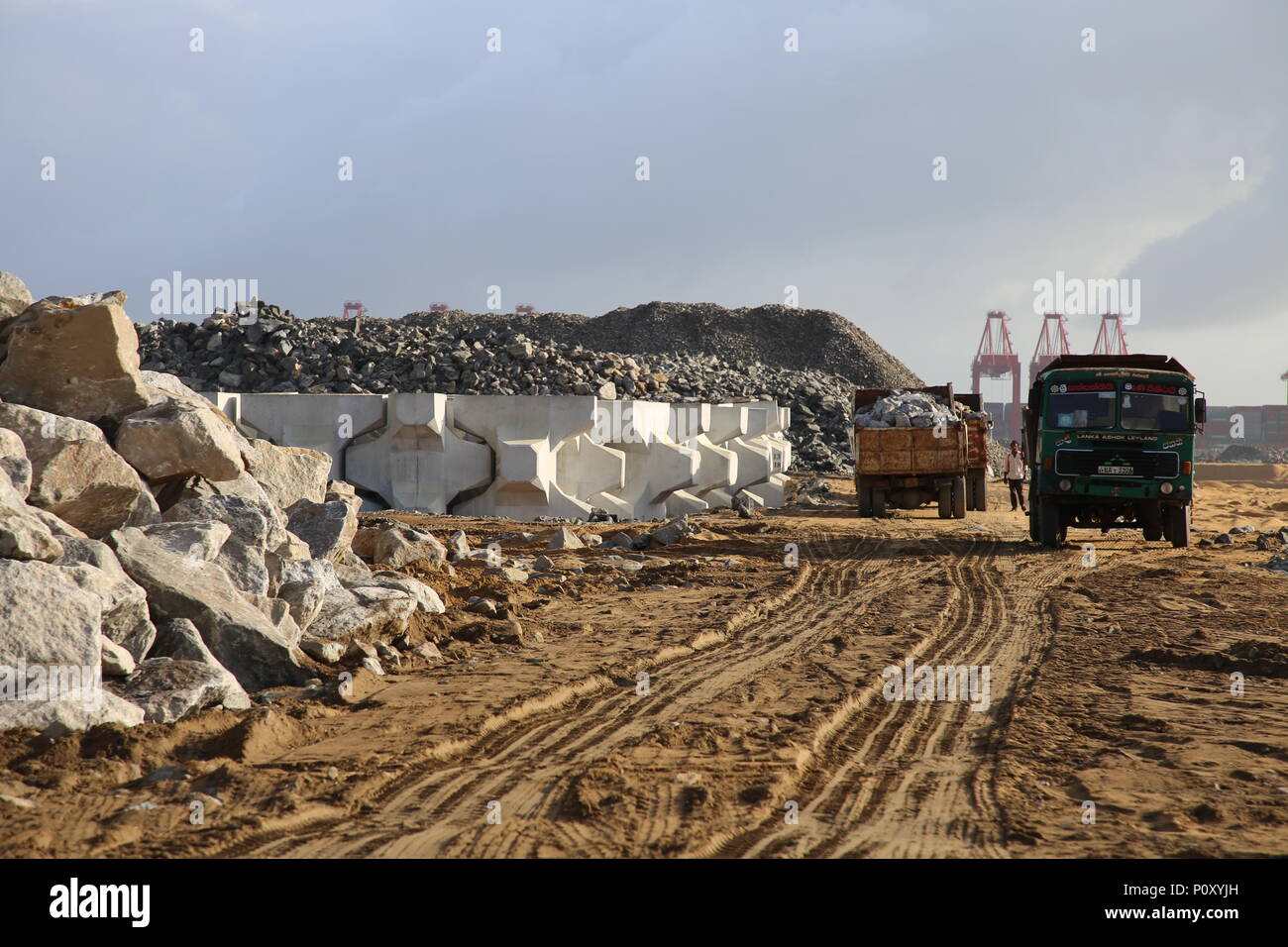 (180610) -- COLOMBO, June 10, 2018 (Xinhua) -- Stones are transported to the construction site of the Colombo Port City, Colombo, Sri Lanka, June 8, 2018. Spread over 269 hectares of land reclaimed from the sea adjacent to the present commercial district of Colombo, the Colombo Port City, co-developed by the Sri Lankan government and China's CHEC Port City Colombo (Pvt) Ltd under the Belt and Road Initiative, will in future become a commercial, financial, residential and international entertainment hub in the Indian Ocean region. TO GO WITH Feature: Story of stone in Colombo Port City (Xinhua/ Stock Photo