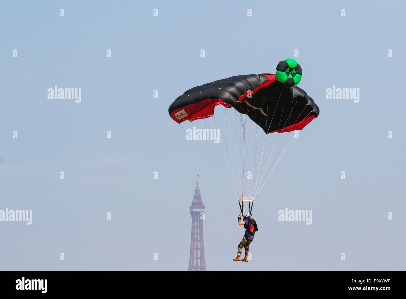 Blackpool, Lancashire, UK. 10/06/2018. The AirgameZ is the definitive BASE jumping competition of the Great British Isles. Elite jumpers from around the world are invited to participate from our 473ft high crane in competition to see who has the nerve, skill & style to thrill the crowds & win the judges scorecards. From this altitude jumpers can expect a solid delay of over 3 seconds, perform staged-deployment multi-ways, AAF style linked exits & aerobatic multi-axis rotations on descent. Credit:MediaWorldImages/AlamyLiveNews. - Stock Image