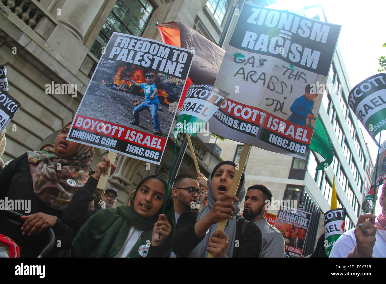 London, UK - 10 June 2018: Young Protestors take part in a demonstration outside the Saudi Arabia Embassy for Al Quds Day on 10 June 2018. The annual event held on the last Friday of Ramadan that was initiated in 1979 to express support for the Palestinians and oppose Zionism and Israel. Credit: David Mbiyu / Alamy Live News - Stock Image