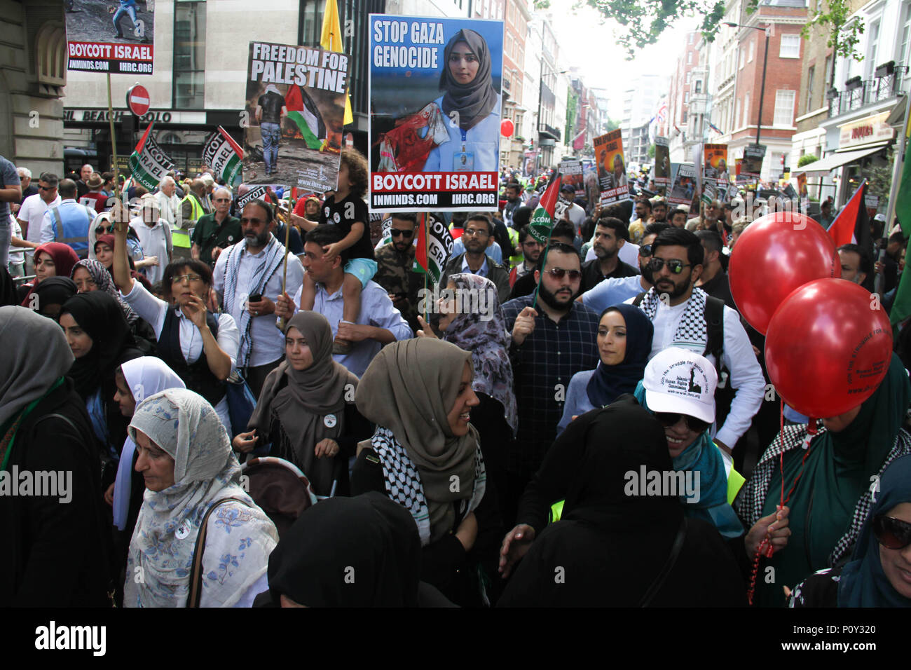 London, UK - 10 June 2018: Protestors take part in a demonstration outside the Saudi Arabia Embassy for Al Quds Day on 10 June 2018. A placard with a photo of the slain Razan al-Najjar, a  21-year-old Palestinian medical nurse shot dead by an Israeli sniper during a Friday protest can be seen held up by a demonstrator. The annual event held on the last Friday of Ramadan that was initiated in 1979 to express support for the Palestinians and oppose Zionism and Israel. Credit: David Mbiyu/ Alamy Live News - Stock Image