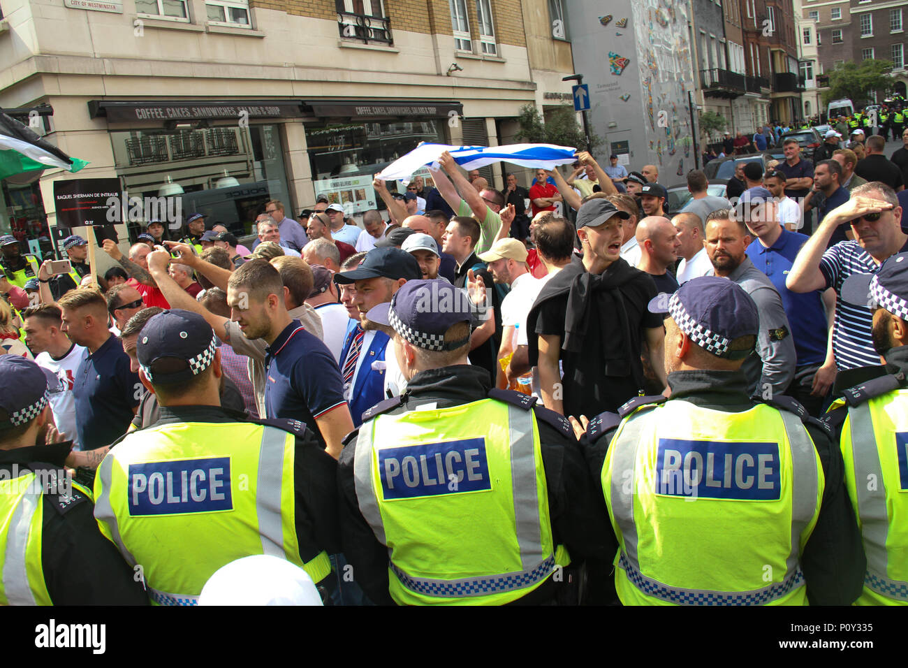 London, UK - 10 June 2018: Free Tommy Robinson supporter held a counter-demonstration as the Al Quds Day demonstration took place outside the Saudi Arabia Embassy for Al Quds Day on 10 June 2018. There was a heavy presence of uniformed police that separated the two groups. The annual event held on the last Friday of Ramadan that was initiated in 1979 to express support for the Palestinians and oppose Zionism and Israel. Credit: David Mbiyu/Alamy Live News Stock Photo