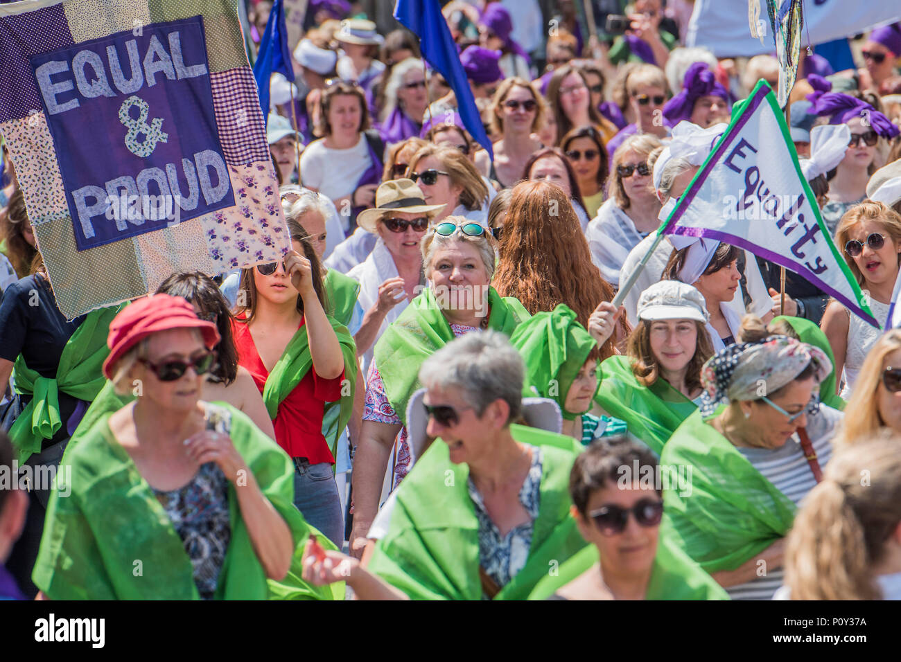 London, UK. 10th June 2018. PROCESSIONS by 14-18 NOW and Artichoke - On 6 February 1918, the Representation of the People Act gave the first British women the right to vote. Artichoke, the UK's largest producer of art in the public realm, invited women and girls to mark this moment by taking part in a major mass-participation artwork. They walk together in public processions, forming a living portrait of women in the 21st century and a visual expression of equality. celebrating the fight for suffrage. Credit: Guy Bell/Alamy Live News - Stock Image