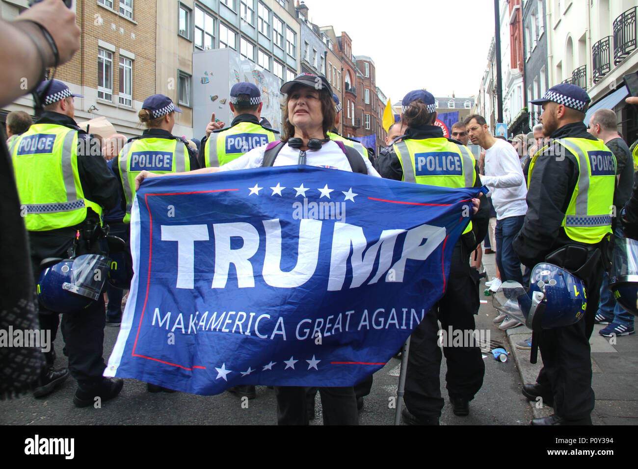 London, UK - 10 June 2018: A female pro-Trump demonstrator by a FRee Tommy Robinson demo group on 10 June 2018.  The Free Tommy Robinson were having a counter demonstration to the Al Quads Day demonstration outside the Saudi Arabian Embassy in  London. The annual event held on the last Friday of Ramadan that was initiated in 1979 to express support for the Palestinians and oppose Zionism and Israel. Credit: David Mbiyu Credit: david mbiyu/Alamy Live News - Stock Image