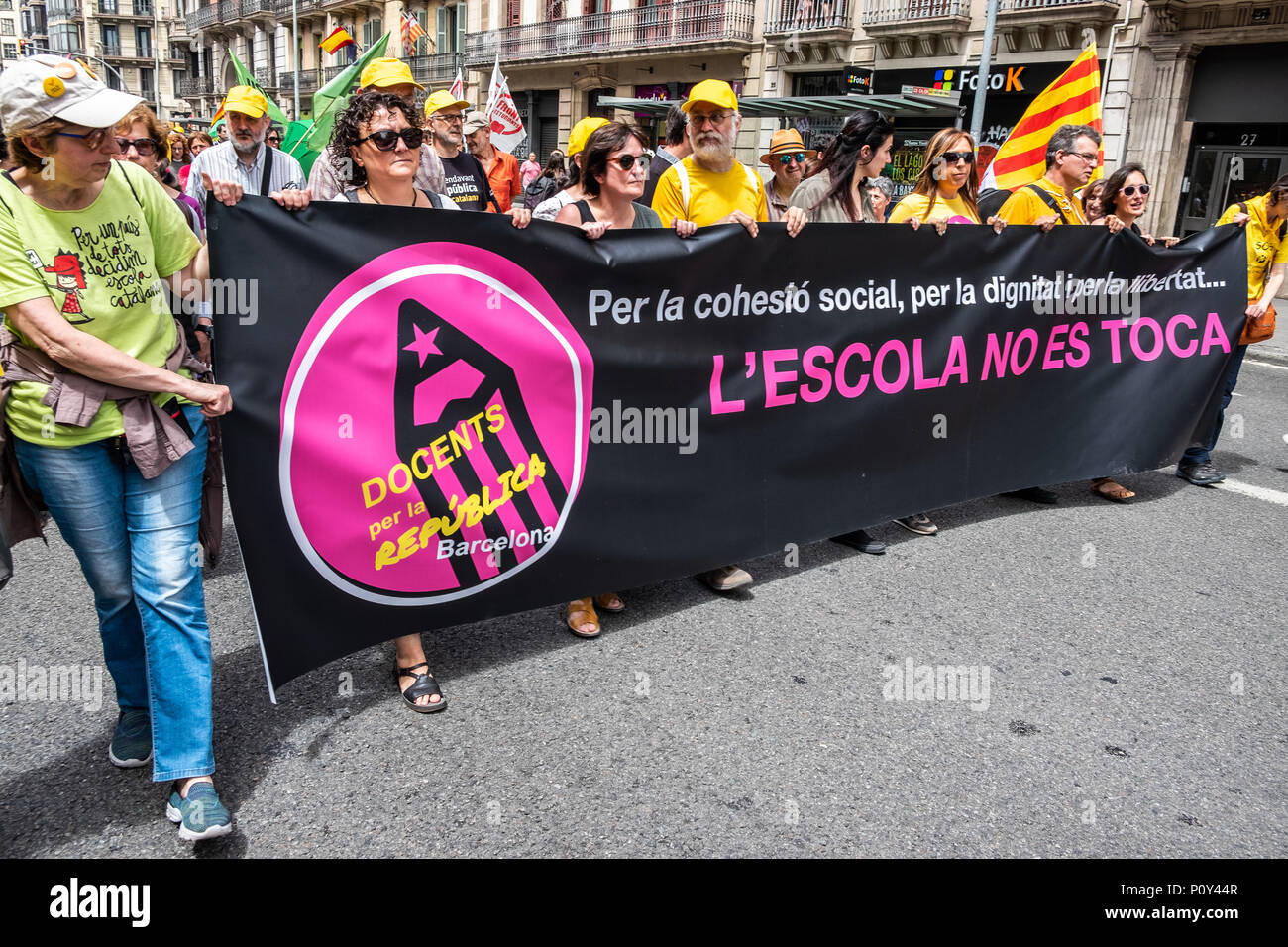 Barcelona, Spain. 10th June 2018. Several demonstrators are seen with a banner with the text 'School should not be touched'.. Hundreds of people called by the major unions of education have attended the demonstration to defend education and in support of one of the secondary schools that has suffered most from the repression of the Spanish state.Professors of the Palau Institute have been accused and prosecuted for 'indoctrination' for defending the right to vote on October 1. Credit: SOPA Images Limited/Alamy Live News - Stock Image