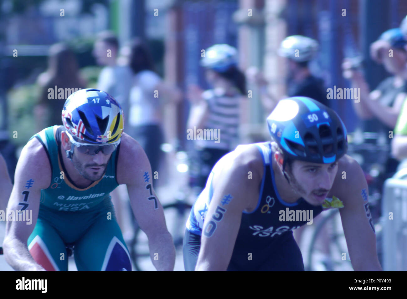 Leeds, UK, 10th June 2018. Richard Murray, Number 17, of RSA, during the cycle, with Sagir Shachar, number 50, from Israel, on his way to winning the ITU World Triathlon Leeds. Credit: Jonathan Sedgwick/ Alamy Live News. - Stock Image