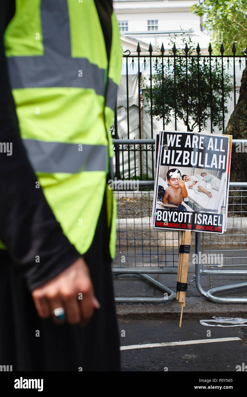 A placard reading 'We Are All Hizbullah / Boycott Israel' rests against railings during the annual pro-Palestine/anti-Israel Al Quds Day demonstration in central London. The demonstration is notably controversial in the city for the flying of Hizbullah flags that typically takes place during the course of it. - Stock Image