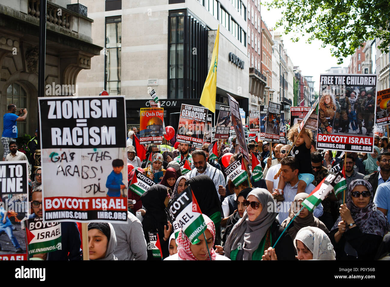 Demonstrators take part in the annual pro-Palestine/anti-Israel Al Quds Day demonstration in central London. The demonstration is notably controversial in the city for the flying of Hizbullah flags that typically takes place during the course of it. - Stock Image